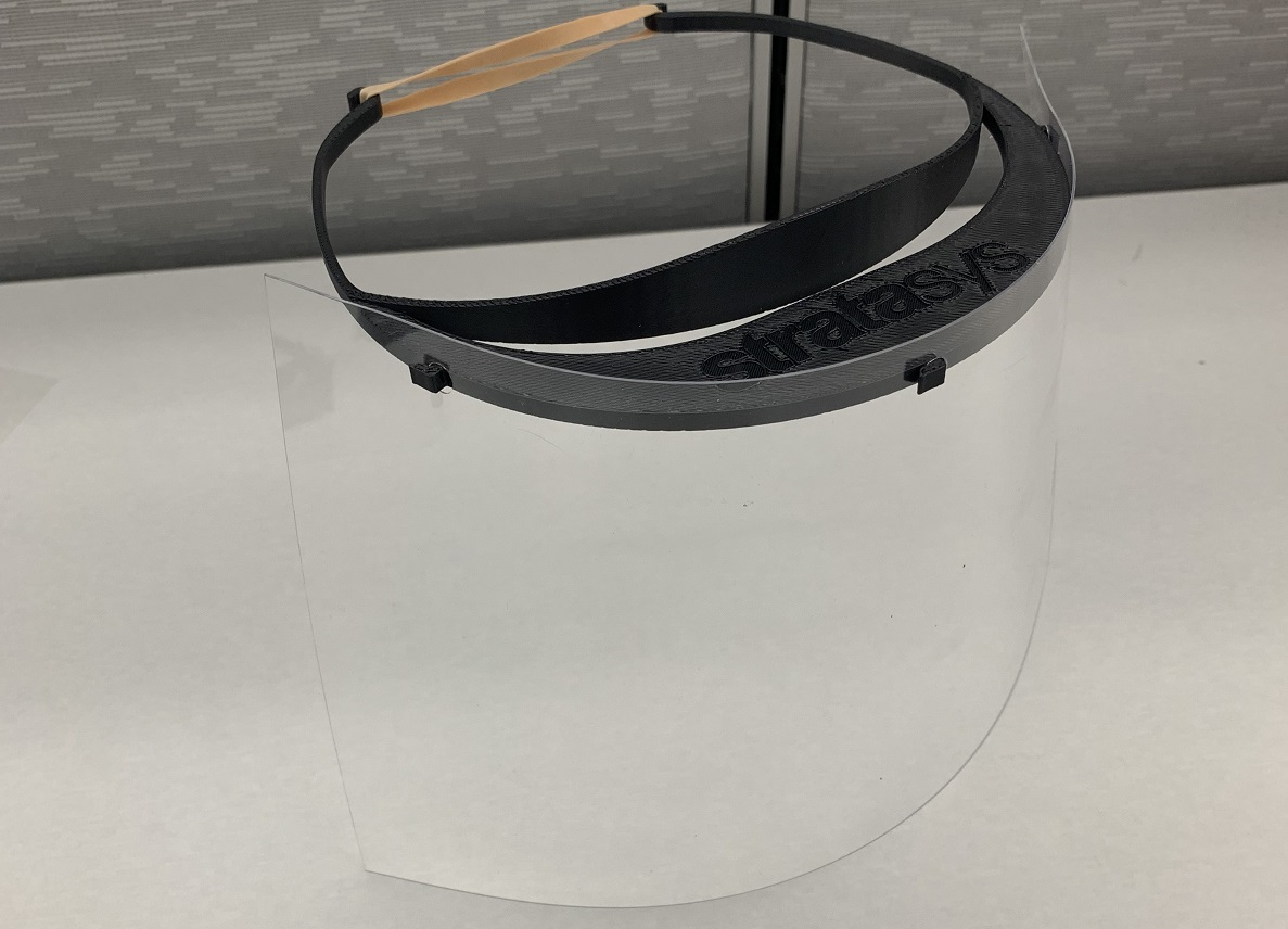 Stratasys is producing thousands of face shields—including both a 3D printed visor and a clear plastic—at no cost to recipients. (Credit: Stratasys)